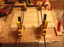 Clamp two bar clamps 1/3 of the way fropm each end