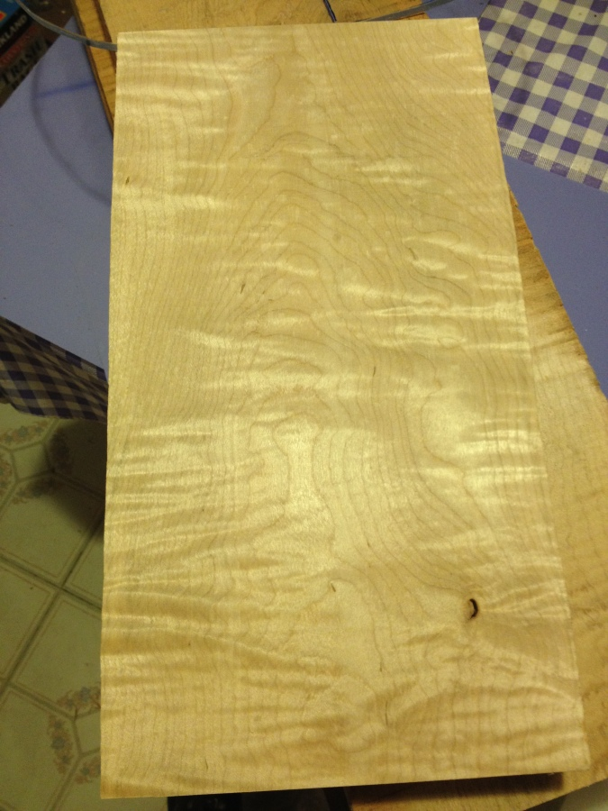 Close up grain sample of the curly maple